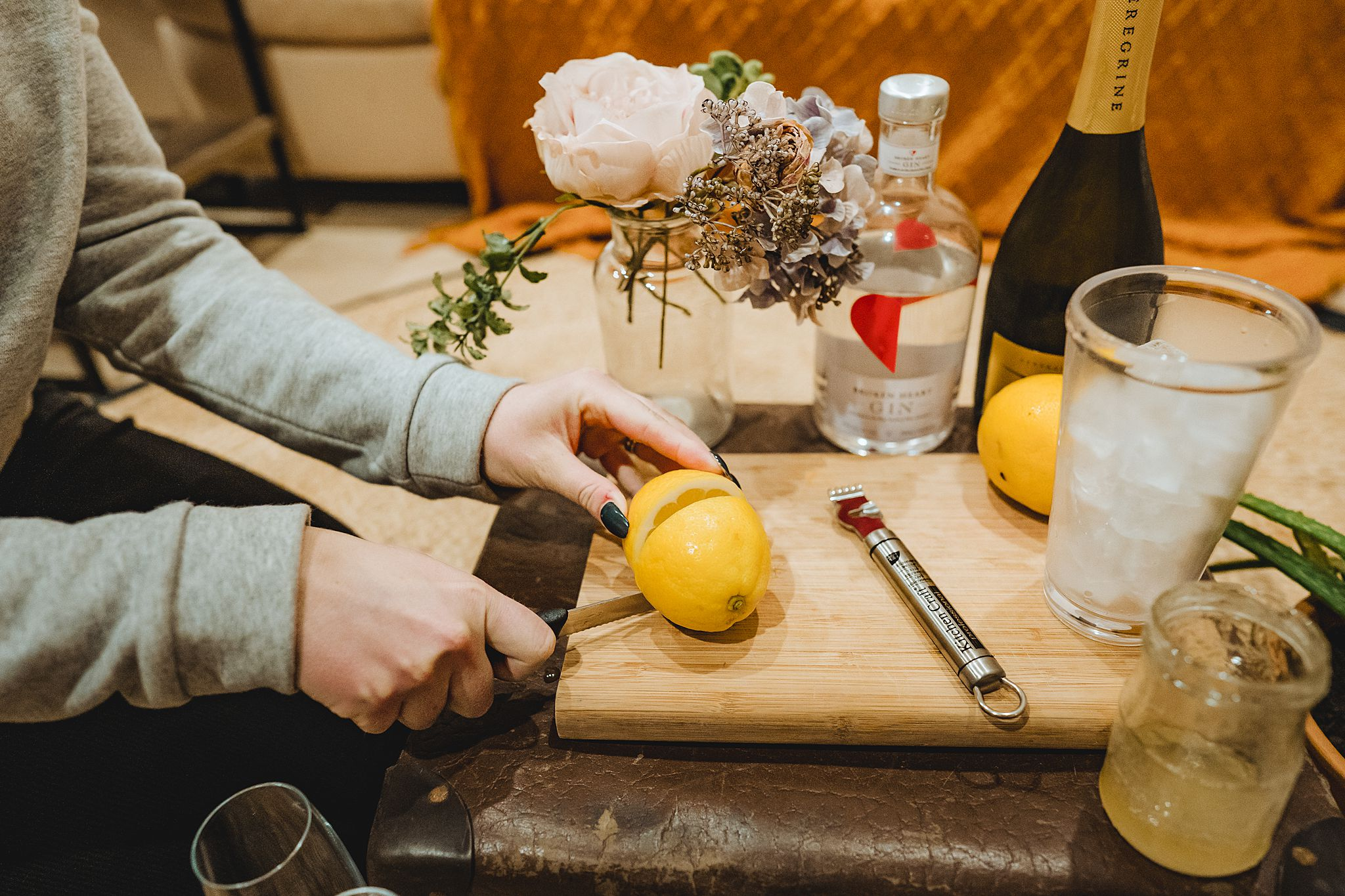 cutting a lemon to make cocktails