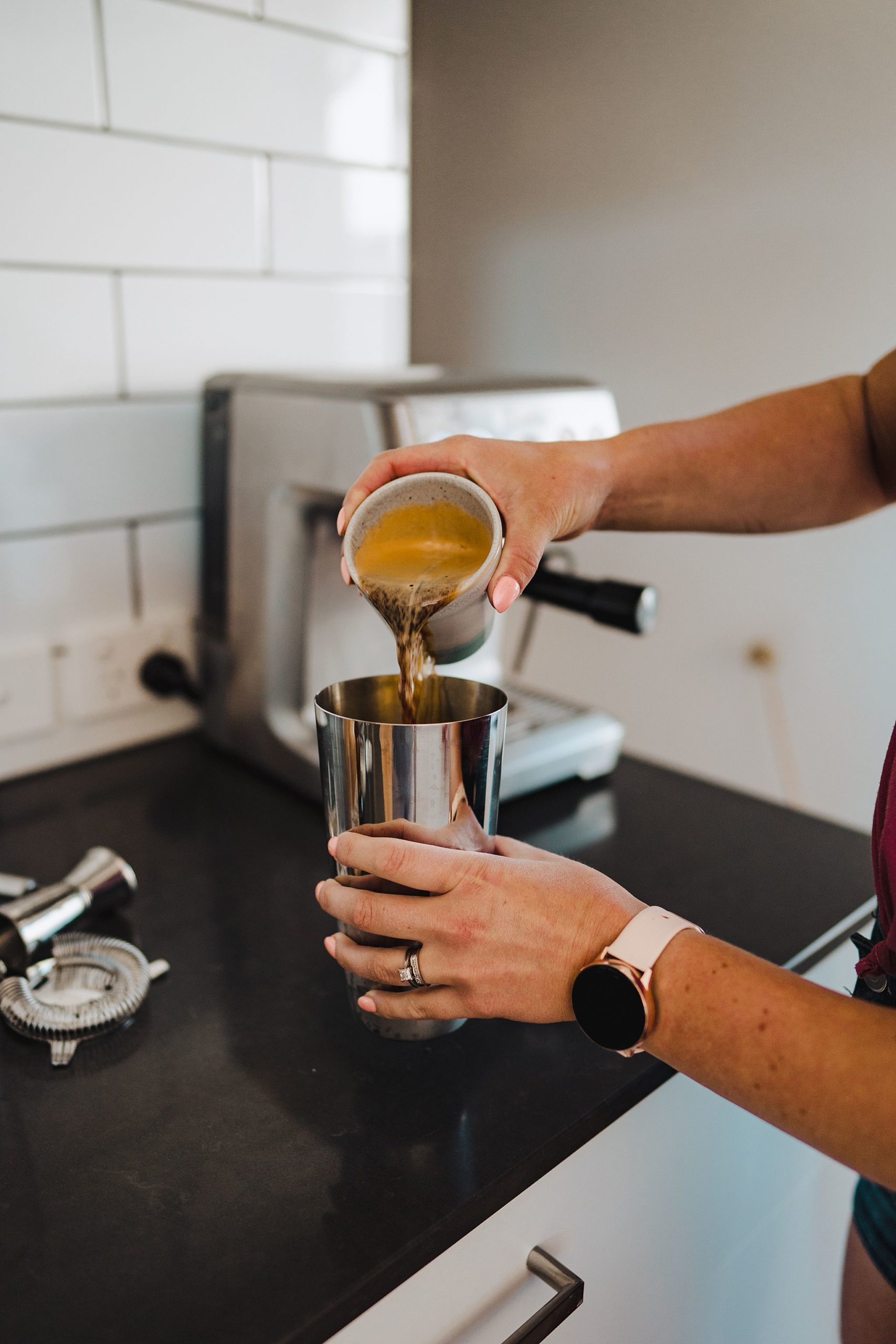 pouring coffee into cocktail shaker