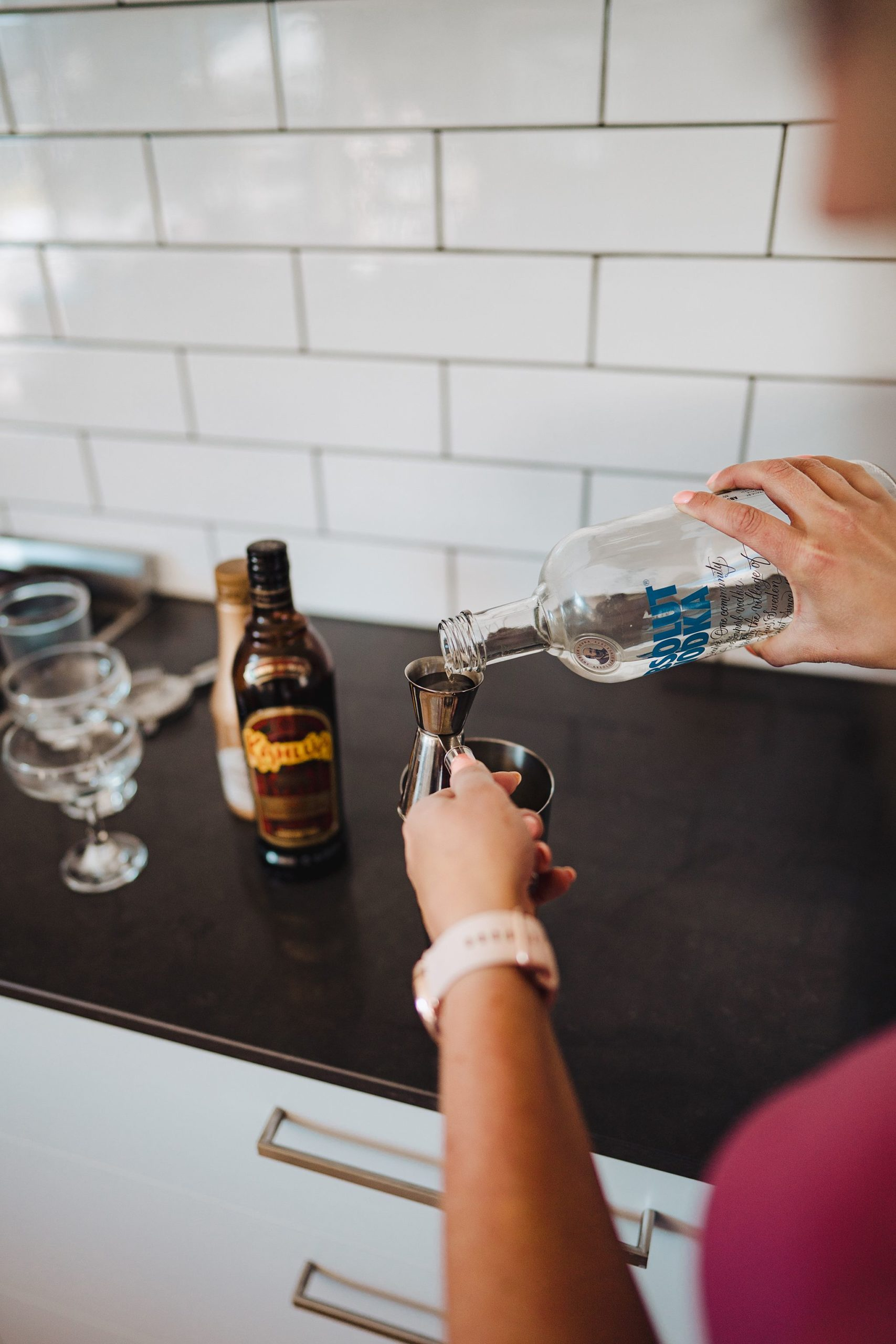 pouring vodka into a cocktail