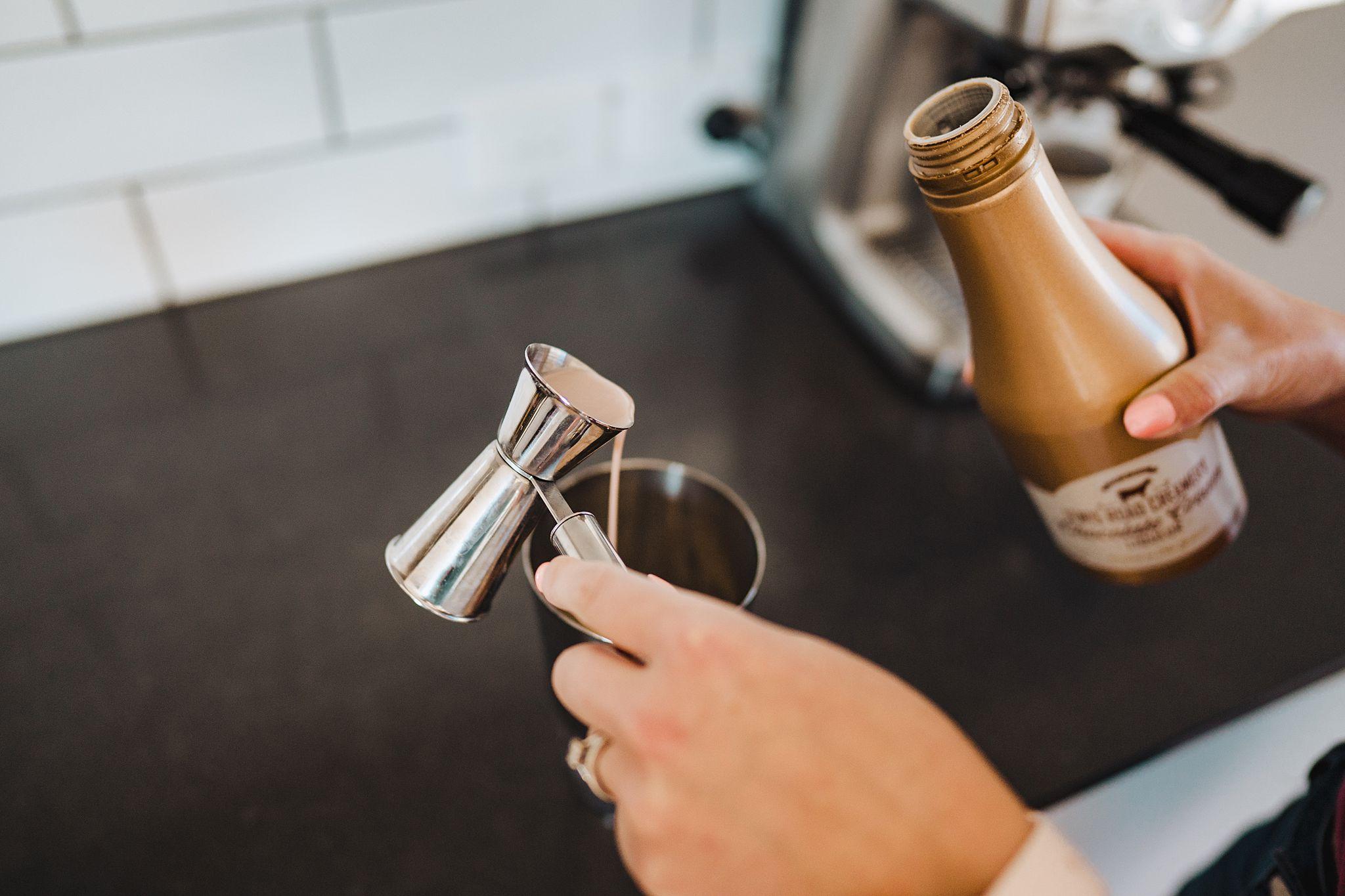 adding chocolate milk liquor to cocktail