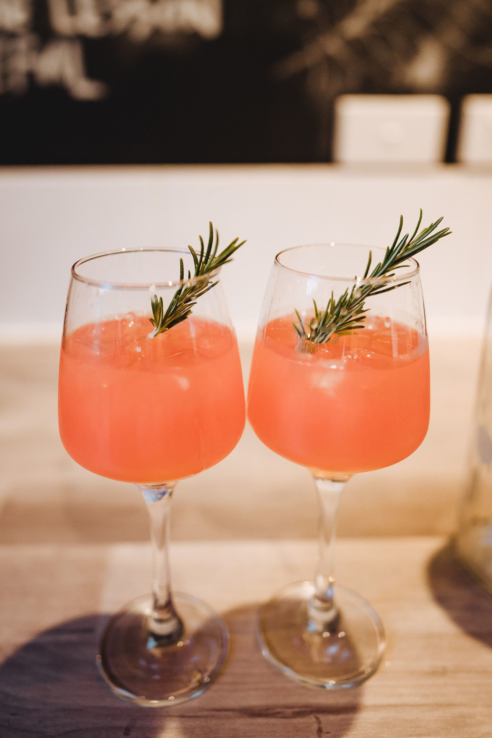 Vodka grapefruit juice and rosemary infused cocktail with fresh rosemary garnish