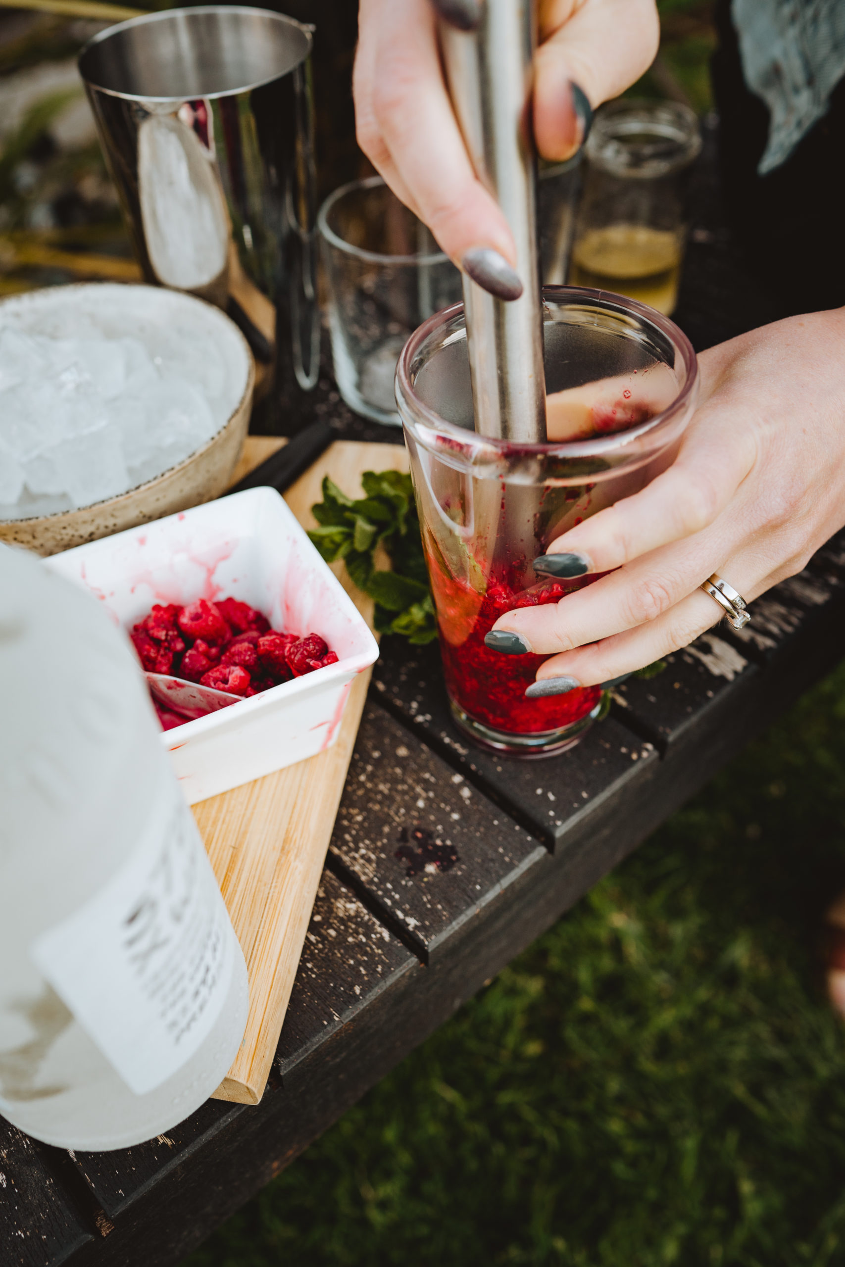 mixing up a raspberry mojito cocktail