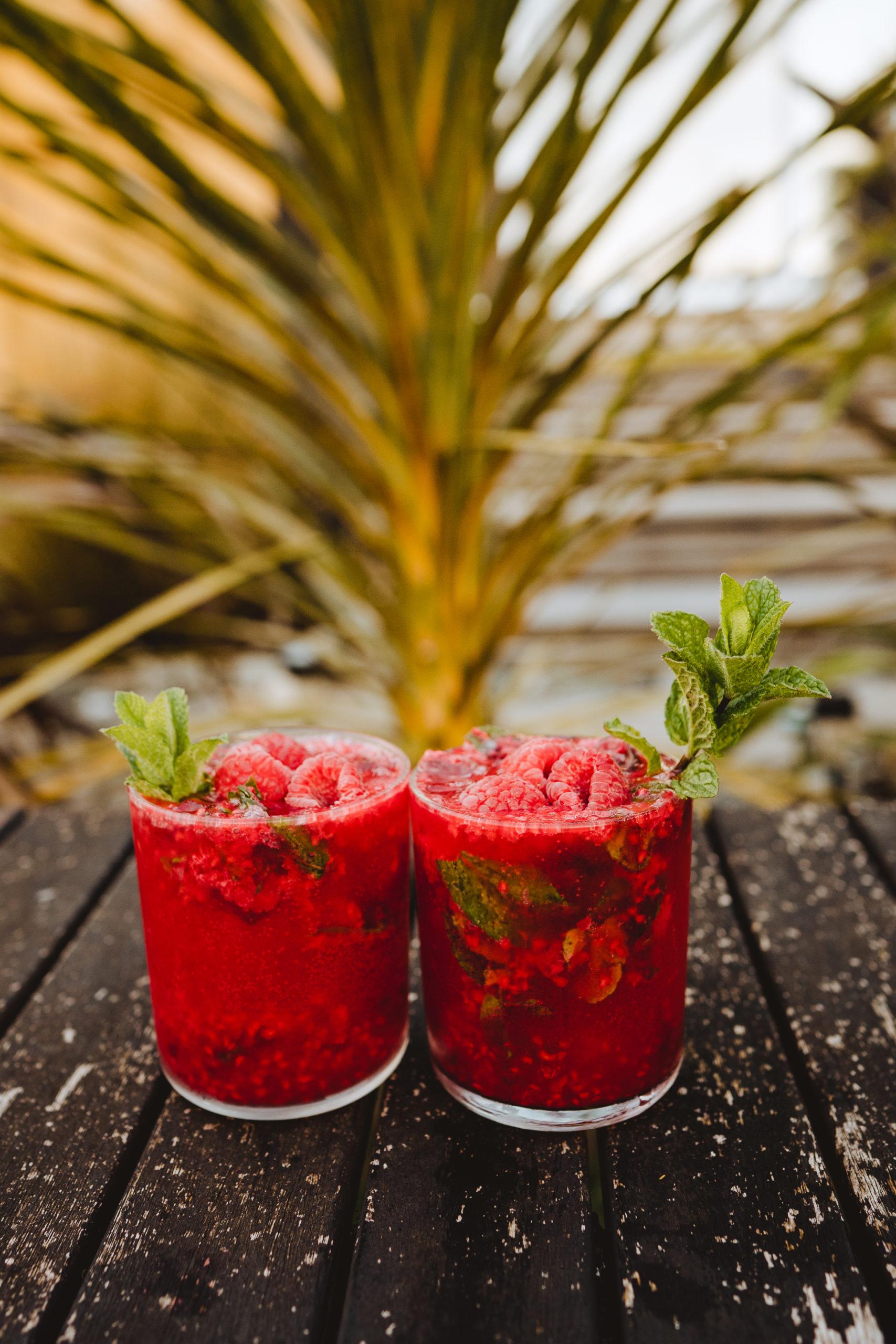 two christmas raspberry mojito cocktails